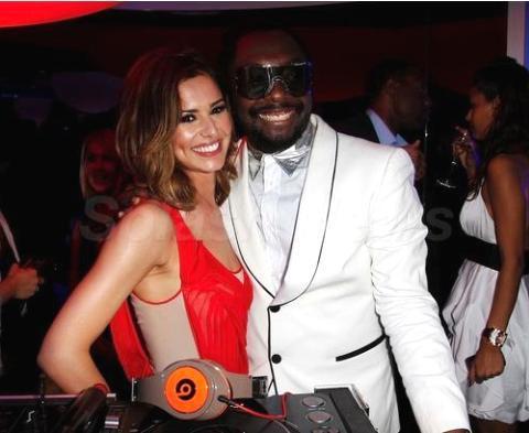 Cheryl Cole và Will.I.Am cùng dự tiệc ở Cannes. Ảnh: Splash.