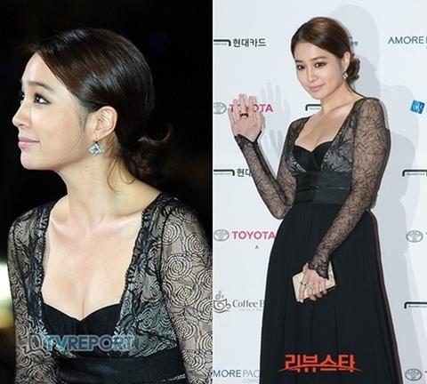 Lee Min Jung chơi tông trầm với cách trang điểm dịu dàng và màu váy tối.