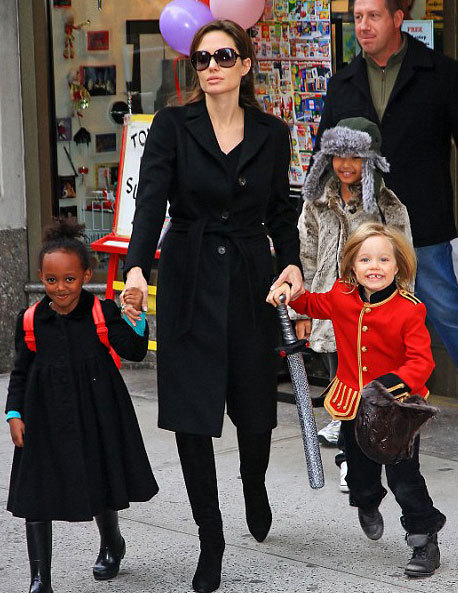 Angelina Jolie takes her children Pax, Shiloh, and Sahara shopping to Lee's art store in New York City (December 7, 2010).