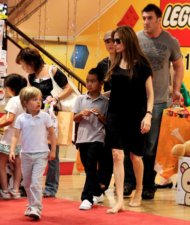 Angelina Jolie with son Maddox (in grey t-shirt) and daughter Shiloh (in white t-shirt) depart the Kiddy Land toy store in Harajuku in Tokyo, Japan (July 26, 2010).