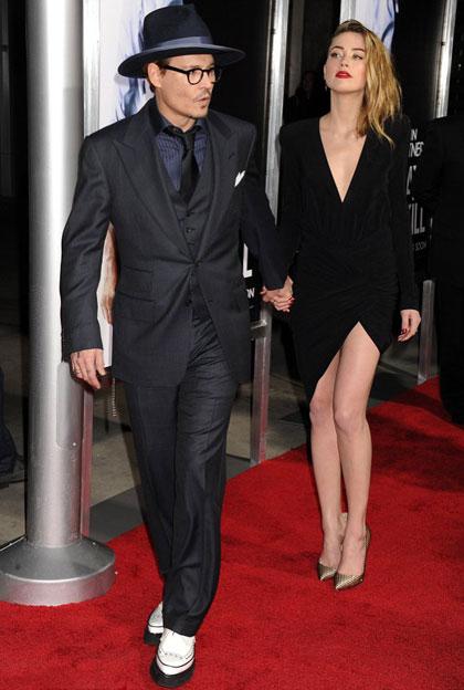 """Johnny Depp và Amber Heard cùng xuất hiện trong buổi ra mắt bộ phim  """"3 Days to Kill"""" hôm 12/2."""