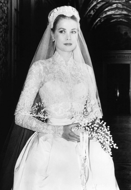 Her ivory wedding dress was made by another Oscar-winning Hollywood costumier, Helen Rose of MGM, and was made up of 300 yards of antique Brussels rose-point lace, 25 yards of heavy taffeta, 100 yards of silk net, 25 yards of silk taffeta, with a three-foot train and tulle veil, all studded with pearls, and is now on display in the Philadelphia Museum of Art.  Read more: http://www.dailymail.co.uk/femail/article-474982/Grace-Kelly--legendary-fashion-icon.html#ixzz2xELZdlxx Follow us: @MailOnline on Twitter | DailyMail on Facebook