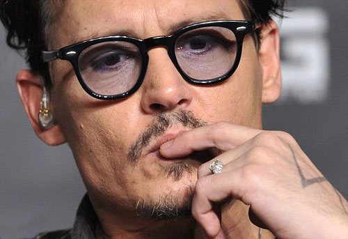Johnny Depp trong sự kiện quảng bá phim ở Trung Quốc. Ảnh: Reuters.