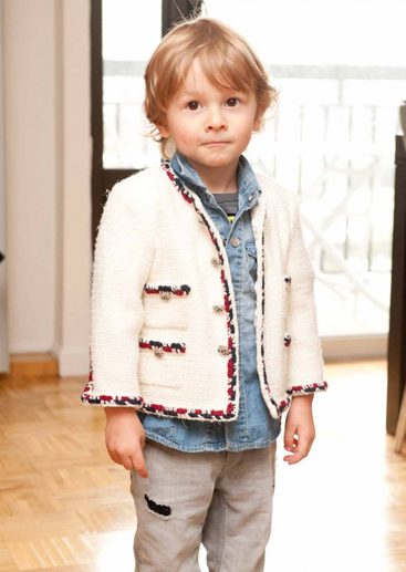 Remember this punim? Let us refresh you. Hudson Kroenig is the adorable toddler who walked with his dad, Brad Kroenigthe inimitable muse to Karl Lagerfeldin the Chanel S/S 11 show. Matching from head-to-toe in a Canadian tuxedo and white Chanel jacket,starting to come back now?Hudsons runway debut with daddy was only the beginning to his booming modeling career. Taking cues from dadthe Abercrombie & Fitch model-turned-Lagerfeld legendlittle Hudsons resumé reads like that of fashions veterans: hes been shot by The Kaiser (numerous times!), graced the pages of German Vogue and posed as the face of Fendi alongside his dapper dad, Anja Rubik and Baptiste Giabiconi. Not bad for a 3-year-old, right? And its no surprise that as the face of Fendi, Hudson is repping hardjacket, sweater, jeans, hat, shoes& you name it, hes got it! Uncle Karlwho shot the Fendi campaignreally is like an uncle to Hud- gifting him stuffed mini Karls to cuddle with at night, visiting him in NYC and hanging with him in Europe. From catwalks to clothes, little H definitely knows a thing or two about style. Its safe to say this kid has a bigger Nike kicks collection than any kid on the playground. Plus- he picks them out himself! But weve got to credit his good-looking dad for his keen sense of style and model material. Brad has fronted the campaigns for Chanel (duh!), H&M, DKNY and Canadian brand, Le Chateau. Muse and magnet to Uncle Karls camera, he has shot him for everything from Harpers Bazaar to the Pirelli Calendar- keeping it PG here, kids. With a dad of this caliber, were sure Hudson has a big future ahead of him. Now thats what we call good jeans!