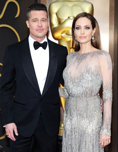 Brad Pitt và Angelina Jolie xin hoãn phien xủ chia quyèn nuoi con