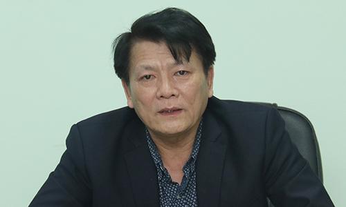 Ông Nguyễn Quang Vinh trong buổi họp chiều 12/2.