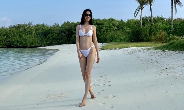 Huỳnh Vy tận hưởng nắng vàng, biển xanh ở Maldives - Giải Trí