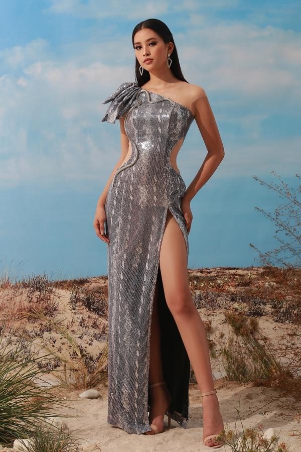 Hoa hậu Tiểu Vy tôn da nâu với đầm lệch vai