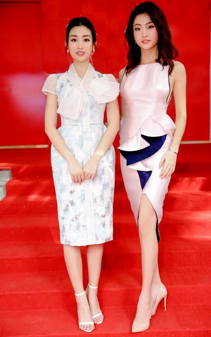 Hoa hậu Hoàn vũ Việt Nam 2019 - Khánh Vân (phải) và Hoa hậu Việt Nam - 2016 Đỗ Mỹ Linh cùng diện phong cách nữ tính, làm tóc đơn giản.